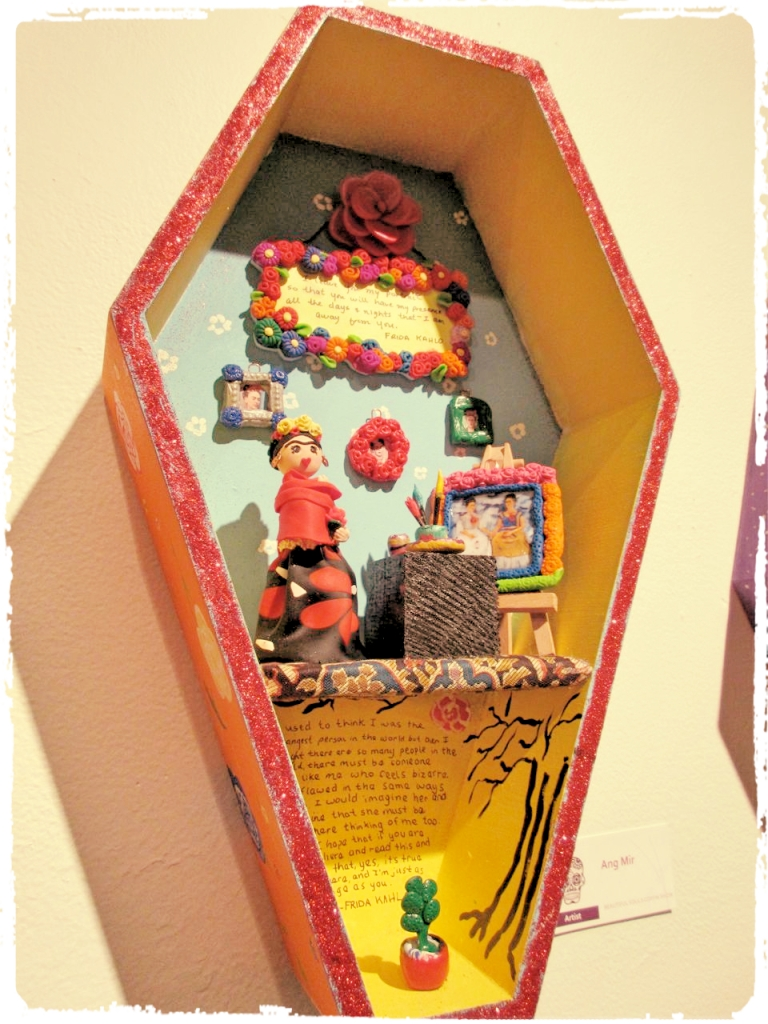 """A delightful Frida Kahlo 'coffin.'  The quote in the bottom half reads: """"""""I used to think I was the strangest person in the world but then I thought there are so many people in the world, there must be someone just like me who feels bizarre and flawed in the same ways I do. I would imagine her, and imagine that she must be out there thinking of me too. Well, I hope that if you are out there and read this and know that, yes, it's true I'm here, and I'm just as strange as you."""""""